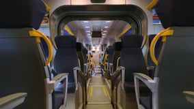 Inside modern passenger train. Train wagon, seats. Fastest public transport stock video