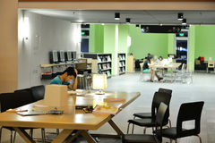 Inside of modern university library, people reading and studying in library hall Stock Photography