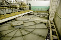 Inside modern wastewater treatment plant. Closed sewage reservoir with dirty water.  royalty free stock photos