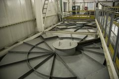 Inside modern wastewater treatment plant. Closed sewage reservoir with dirty water.  stock photos