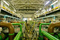 Inside modern wastewater treatment plant, filters, pipeline and purification equipment.  royalty free stock photo