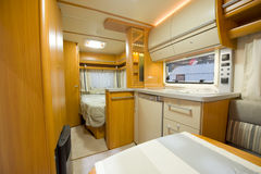 Inside motor home detail. View inside a new motor home camper with interior and decoration around Stock Image