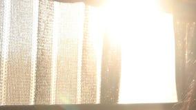 Inside the moving bus. Evening sun splash through the curtains