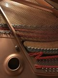 Piano instrument inside. Inside of the music instrument. Closeup on parts making a sound Royalty Free Stock Photos