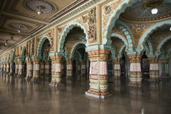 Inside the Mysore Royal Palace, India. Royal Palace of Mysore, India. Columns and arches decorated with colorful paintings royalty free stock images