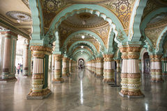 Inside the Mysore Royal Palace, India. Royal Palace of Mysore, India. Columns and arches decorated with colorful paintings stock photo