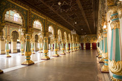 Inside the Mysore Royal Palace, India. Royal Palace of Mysore, India. Columns and arches decorated with colorful paintings stock photography