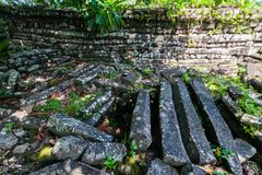 Inside Nan Madol: walls, and secret underground room. Overgrown ruins in the jungle, Pohnpei, Micronesia, Oceania. royalty free stock image