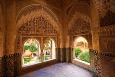 Inside the Nasrid Palace, the Alhambra, Granada, Spain. The ornate plaster and tile interior of one of the Emperors rooms in the Nasrid Palace at the Alhambra Stock Image