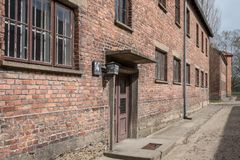 Inside the Nazi Concentration Camp of Auschwitz 1 showing the barrack buildings where prisoners lived in appalling conditions. Inside the Nazi Concentration Camp royalty free stock photos