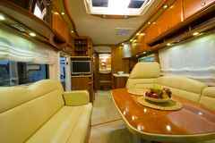 Inside new motor home. View inside a large new motor home camper with interior and decoration around Stock Image