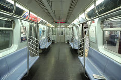 Inside of NYC Subway Car at Eighth Avenue Station in Manhattan. NEW YORK - APRIL 4, 2017: Inside of NYC Subway Car at Eighth Avenue Station in Manhattan. Owned Stock Photo