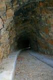Inside Obsolete Railroad Tunnel. A sidewalk built through an obsolete railroad tunnel Stock Photo