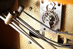 Inside old clock. View of old clock inside mechanism Royalty Free Stock Photo