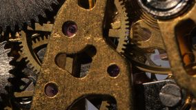 Inside of an old clock mechanism. Close up stock footage
