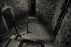 Inside of old creepy abandoned mansion. Staircase and colonnade. Dark castle stairs to the basement. Spooky dungeon stone stairs i. N old castle. Horror royalty free stock photography
