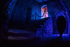 Inside of old creepy abandoned mansion. Staircase and colonnade. Dark castle stairs to the basement. Spooky dungeon stone stairs i. N old castle. Horror royalty free stock photo