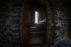 Inside of old creepy abandoned mansion. Staircase and colonnade. Dark castle stairs to the basement. Spooky dungeon stone stairs i. N old castle. Horror stock images