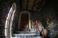 Inside of old creepy abandoned mansion. Staircase and colonnade. Dark castle stairs to the basement. Spooky dungeon stone stairs i. N old castle. Horror stock photography