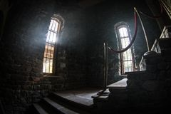Inside of old creepy abandoned mansion. Staircase and colonnade. Dark castle stairs to the basement. Spooky dungeon stone stairs. In old castle. Horror royalty free stock photos