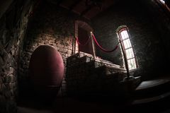 Inside of old creepy abandoned mansion. Staircase and colonnade. Dark castle stairs to the basement. Spooky dungeon stone stairs. In old castle. Horror royalty free stock photography
