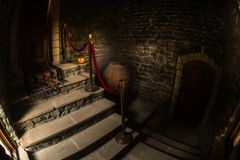 Inside of old creepy abandoned mansion. Staircase and colonnade. Halloween pumpkin on dark castle stairs to the basement. Spooky dungeon stone stairs in old stock photos