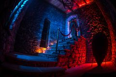 Inside of old creepy abandoned mansion. Staircase and colonnade. Silhouette of horror ghost standing on castle stairs to the royalty free stock photography