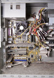 Inside of the old, disassembled, covered with dust computer Stock Photos