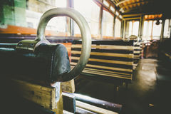 The inside of old electrical and yellow seats Stock Photo