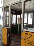 The inside of an old historic yellow tram with graffiti in Lisbon Royalty Free Stock Images