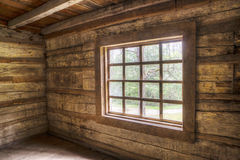 Inside of an old log home facing windows. Stock Image