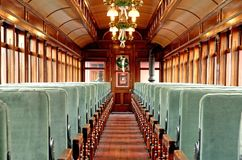 Inside an Old Passenger Rail Car. Inside view of a restored Victorian-era Passenger Rail Car royalty free stock photo