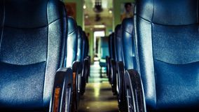 Inside of railway train with seats vintage style. Inside of old public Thai railway train cabin with seats, handrails, fan and interior in vintage style service stock photos