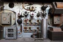 Inside of an old radio set. View of an open old dusty analog radio with very big parts of old technology Royalty Free Stock Images