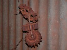 Old Shearing Shed, with Windmill Gears hanging on a wall. stock photo