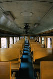 Inside old Thai diesel train with a few passengers sitting down Stock Image