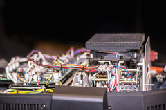 Inside of an opened electronical device with wires, radio elemen Stock Images