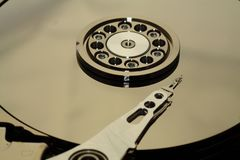 Inside a open HDD. Inside a opened hard disc drive stock photography