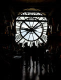 Inside orsay museum and there is a big clock two people stand beside the clock stock image