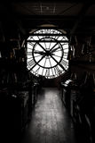 Inside orsay museum and there is a big clock two people stand beside the clock Stock Photo