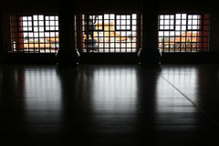 Inside out. In a sacred buddhist temple looking at three windows Stock Images