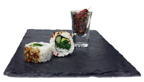 Inside-out Flower Roll with Spinach, Cucumber and chilli on slate Stock Photography