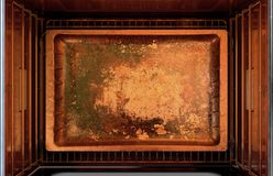 Inside The oven. A cross section top view from above an empty hot operational household oven with an empty tanished baking tray - 3D render Royalty Free Stock Images