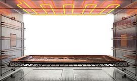 Inside The oven. A view from inside a hot operational household oven looking out the open door with an empty tanished baking tray inside - 3D render Royalty Free Stock Photo