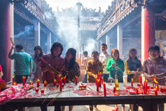 Inside the pagoda burned incense candles Stock Photo