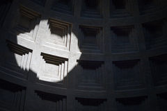 Inside The Pantheon, Rome. A telephoto view from within The Pantheon, one of Rome's most popular landmarks, with focus on the sunlight shining on the internal stock photography