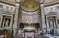 Inside Pantheon - Rome. View of the main altar in Pantheon, Rome, Italy.The present high altar and the apse were commissioned by Pope Clement XI in the early Stock Image