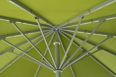 Inside of a parasol. Metal ribs of a large green sunshade Royalty Free Stock Photography