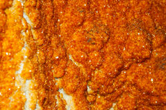 Inside part of geode mineral with orange crystals Stock Photo