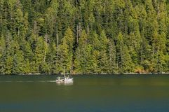 Inside Passage, BC, Canada - September 13, 2018: The Alki, an Alaskan fishing troller built in 1925 in Tacoma royalty free stock photo